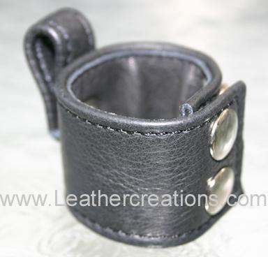 Garment leather ball stretcher which attached to a cock ring